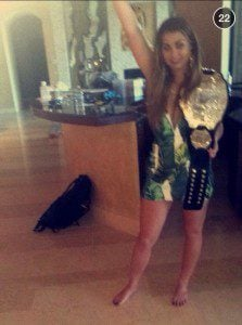 New leaked photo of party girl holding Conor's belt.