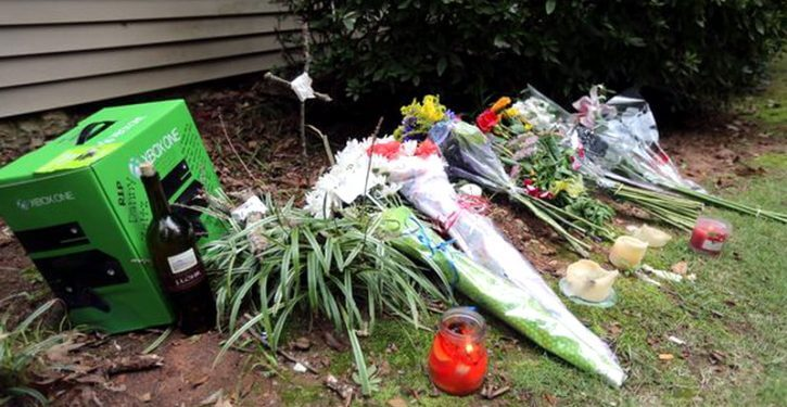 A makeshift memorial outside of the Victim's house