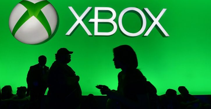 People walk past the Xbox section at E3 - the Electronic Entertainment Expo - an annual video game conference and show at the Los Angeles Convention Center on June 16, 2015 in Los Angeles, California. AFP PHOTO / FREDERIC J. BROWN        (Photo credit should read FREDERIC J. BROWN/AFP/Getty Images)
